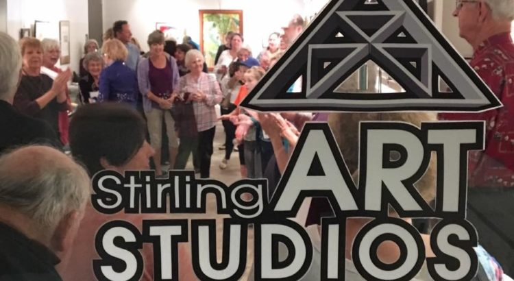 Visitors tour the Stirling Art Studios & Gallery space looking at art and hearing a presentation.