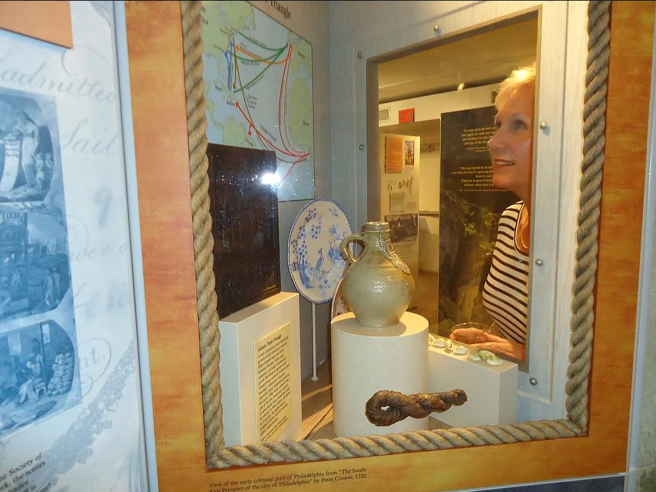 woman looks at Dunedin History Museum exhibit